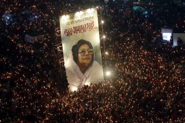 People attend a mass candlelight vigil around a portrait of Jahanara Imam, a late political activist pioneer widely known to bring the accused of committing war crimes in the Bangladesh Liberation War to trial, at Shahbagh intersection in Dhaka