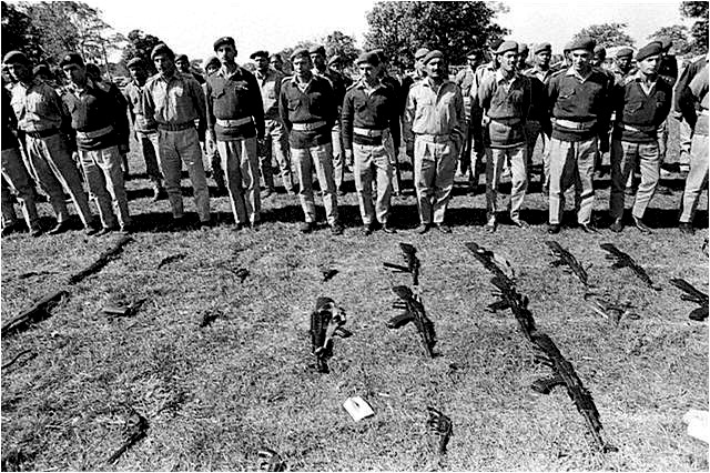 large-Pakistani Army officers lay down their arms in December 1971 during a surrender ceremony on the golf course of the Dhaka Military Cantonment
