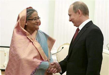 Russian President Putin shakes hands with Bangladesh PM Hasina during their meeting in Moscow's Kremlin