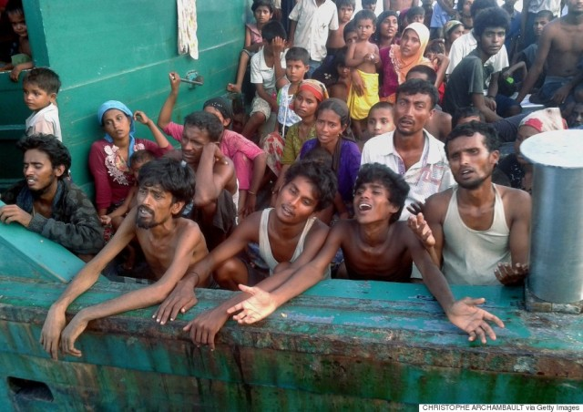 Rohingya migrants are pictured on a boat off the southern Thai island of Koh Lipe in the Andaman Sea on May 14, 2015. The boat crammed with scores of Rohingya migrants -- including many young children -- was found drifting in Thai waters on May 14, according to an AFP reporter at the scene, with passengers saying several people had died over the last few days. Dozens of visibly weak-looking people were on the deck of the stricken vessel, which was found apparently adrift several kilometres off Koh Lipe.   AFP PHOTO / Christophe ARCHAMBAULT        (Photo credit should read CHRISTOPHE ARCHAMBAULT/AFP/Getty Images)
