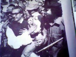 Bangabandhu with Sheikh Russel in his lap