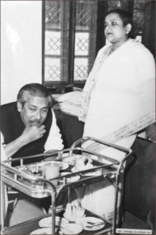 Begum Mujib watches as Bangabandhu takes his meal.