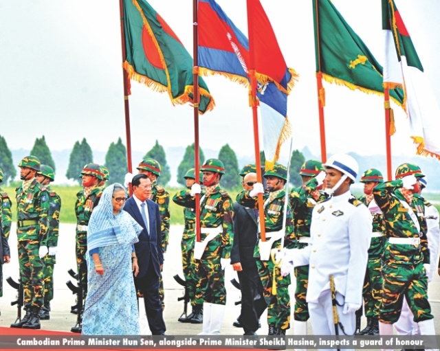 Cambodian Prime Minister Hun Sen, alongside Prime Minister Sheikh Hasina, inspects a guard of honour