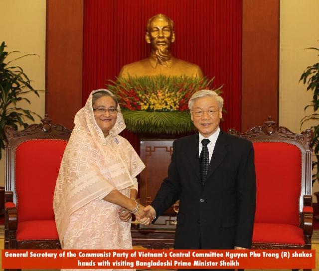 General Secretary of the Communist Party of Vietnam's Central Committee Nguyen Phu Trong (R) shakes hands with visiting Bangladeshi Prime Minister Sheikh