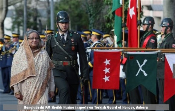 Bangladeshi Prime Minister Sheikh Hasina inspects a military guard of honour in Ankara, Turkey, Thursday, April 12, 2012. Sheikh Hasina is in Turkey for a three-day state visit.(AP Photo/Burhan Ozbilici)