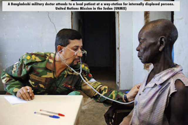 A Bangladeshi military doctor attends to a local patient at a way-station for internally displaced persons. United Nations Mission in the Sudan (UNMIS)