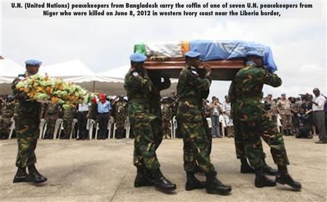 U.N. (United Nations) peacekeepers from Bangladesh carry the coffin of one of seven U.N. peacekeepers from Niger who were killed on June 8, 2012 in western Ivory coast near the Liberia border,