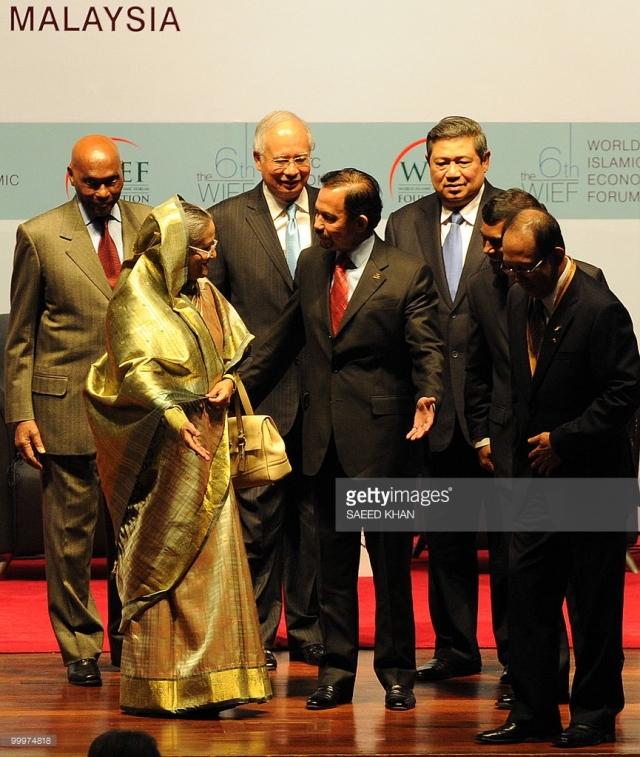 bruneis-sultan-hassanal-bolkiah-c-offers-bangladeshs-prime-minister-sheikh-hasina-l